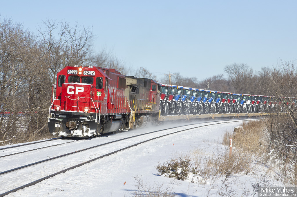 canadian pacific train 288 delivers tractors and more on christmas eve sparkling sd60 6222 is head out trailed by a warbonnet painted bnsf ge